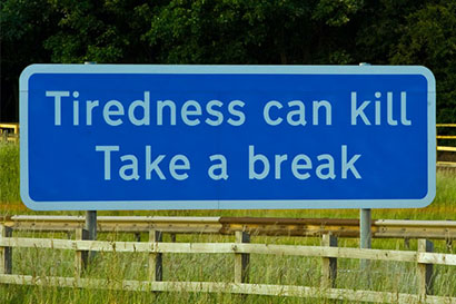 Road sign saying: Tiredness can kill Take a break